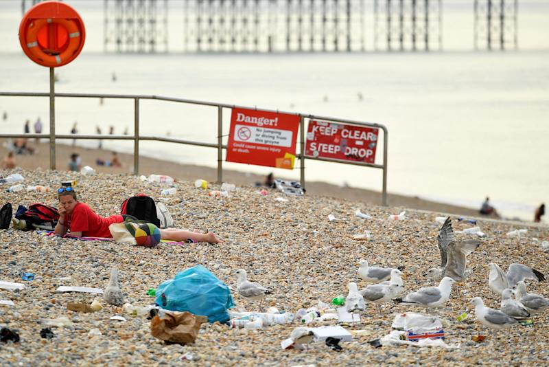 Brighton beach covered in litter on Saturday morning (REUTERS)