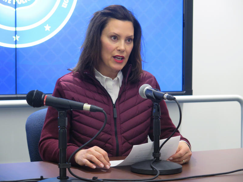 FILE - In this Tuesday, March 10, 2020, file photo, Michigan Gov. Gretchen Whitmer announces the state's first two cases of coronavirus, at the Michigan State Police headquarters in Windsor Township, Mich. Coronavirus cases in Michigan rose sharply late Thursday, March 12, 2020, as officials announced more cases, and as some K-12 schools began announcing closures while others began training staff to potentially move to online learning only. (AP Photo/David Eggert, File)