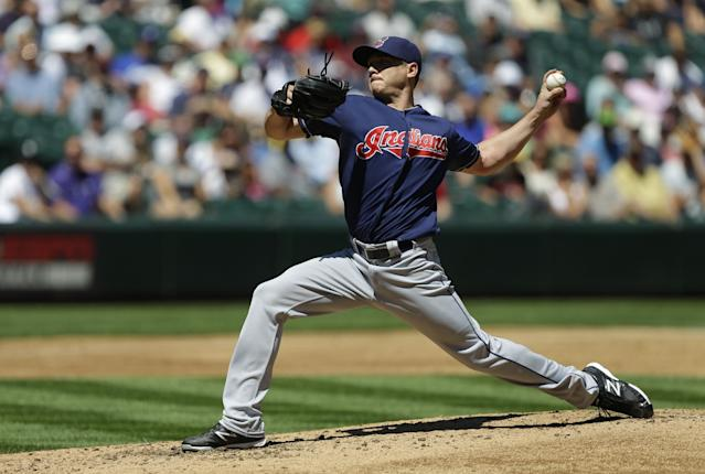 Cleveland Indians starting pitcher Scott Kazmir throws against the Seattle Mariners in the third inning of a baseball game, Wednesday, July 24, 2013, in Seattle. (AP Photo/Ted S. Warren)