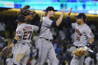 The Houston Astros celebrate a 3-0 win over the Los Angeles Dodgers in a baseball game Tuesday, Aug. 3, 2021, in Los Angeles. (AP Photo/Marcio Jose Sanchez)