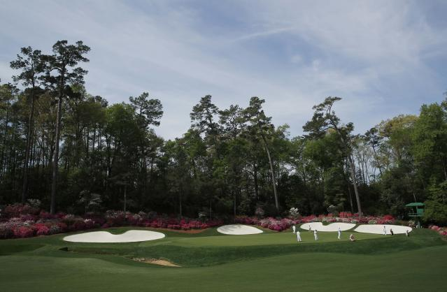 Players at the 12th hole during practice for the 2018 Masters golf tournament at Augusta National Golf Club in Augusta, Georgia, U.S. April 2, 2018. REUTERS/Mike Segar