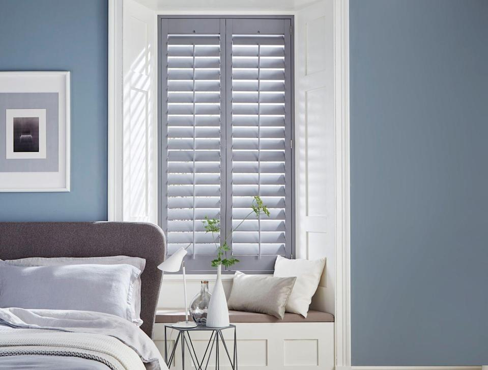 """<p>Pale grey shutters look so elegant in this bedroom, filtering the light beautifully. They fit neatly into the recess leaving room for a small window seat. Leave the shutters open during the day and close them at night. For this grey bedroom idea, the pearl grey shade of the shutters sits perfectly with the blue and cream colour scheme in the rest of the room.<br></p><p>'Your bedroom is a space you want to feel calm and safe, and grey is a neutral shade which can offer this. Any window covering is an investment, especially shutters, so make the right decision with colour and how it complements your colour scheme,' says Victoria Walker, product manager at <a href=""""https://www.hillarys.co.uk/"""" rel=""""nofollow noopener"""" target=""""_blank"""" data-ylk=""""slk:Hillarys"""" class=""""link rapid-noclick-resp"""">Hillarys</a>. 'Grey is a timeless colour but there are many tones to choose from. Lighter shades offer a cooler, fresher space whereas darker greys and charcoal tones can do the opposite. Choosing the right shade also depends if you want your window covering to blend in or become a feature in the room.'</p><p>Pictured: <a href=""""https://www.hillarys.co.uk/products/storm-grey-shutter/"""" rel=""""nofollow noopener"""" target=""""_blank"""" data-ylk=""""slk:Storm Grey full height shutters, House Beautiful collection at Hillarys"""" class=""""link rapid-noclick-resp"""">Storm Grey full height shutters, House Beautiful collection at Hillarys</a></p>"""