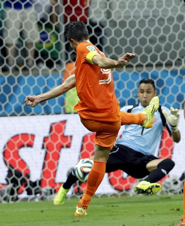 Costa Rica's goalkeeper Keylor Navas (1) stops a shot by Netherlands' Robin van Persie (9) during the World Cup quarterfinal soccer match between the Netherlands and Costa Rica at the Arena Fonte Nova in Salvador, Brazil, Saturday, July 5, 2014. (AP Photo/Hassan Ammar)