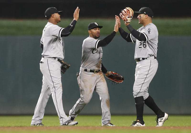 The three Chicago White Sox outfielders, all named Garcia, celebrate the White Sox 2-1 win over the Minnesota Twins in a baseball game Friday, April 14, 2017, in Minneapolis. From left are Willy Garcia, Leury Garcia and Avisail Garcia. (AP Photo/Jim Mone)