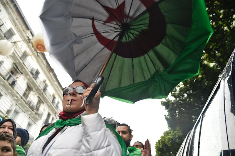 The national flag has become an indispensable accessory for the protesters (AFP Photo/RYAD KRAMDI                        )