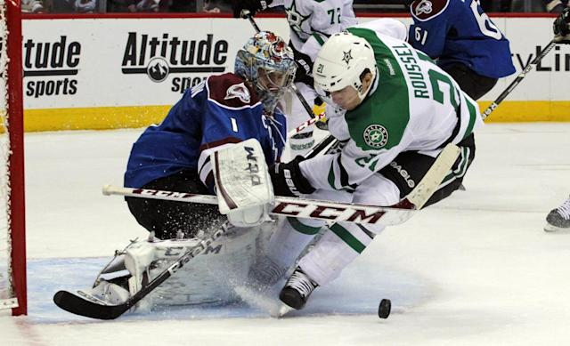 Colorado Avalanche goalie Semyon Varlamov (1), of Russia, stops a drive on goal by Dallas Stars left wing Antoine Roussel (21), of France, during the second period of an NHL hockey game in Denver on Tuesday, Oct. 15, 2013. (AP Photo/Joe Mahoney)