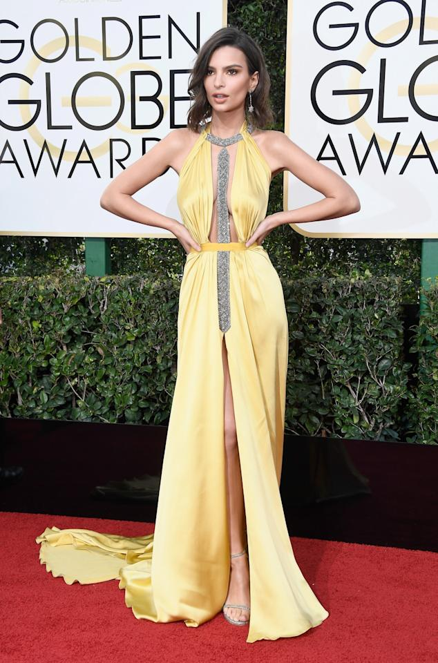 <p>A keyhole neckline and high-cut center slit made Emily Ratajkowski's Reem Acra gown one of the most revealing on the red carpet. (Photo: Getty Images) </p>