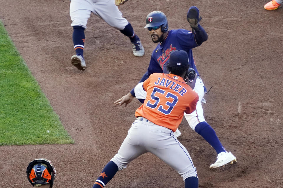 Houston Astros pitcher Cristian Javier (53) tags out Minnesota Twins' Byron Buxton during an eighth inning rundown between first and second in Game 2 of a American League wild-card baseball series, Wednesday, Sept. 30, 2020, in Minneapolis. The Astros won the series with their 3-1 win. (AP Photo/Jim Mone)