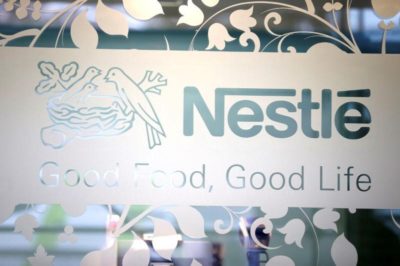 FILE PHOTO: Nestle logo is pictured on the door of the supermarket of Nestle headquarters in Vevey