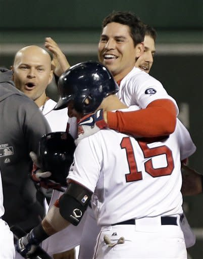 Boston Red Sox's Jacoby Ellsbury celebrates his game-winning RBI single against the New York Yankees with teammates Dustin Pedroia (15) and Cody Ross, left, in the ninth inning of a baseball game at Fenway Park in Boston, Tuesday, Sept. 11, 2012. The Red Sox won 4-3. (AP Photo/Elise Amendola)