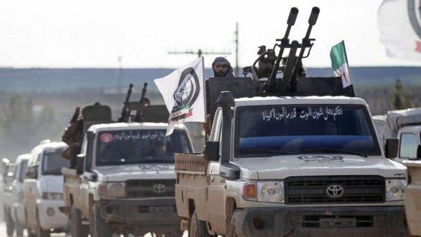 PHOTO: A Turkish-backed Syrian rebel rides on a truck with a mounted weapon in the Manbij countryside, Syria, Dec. 28, 2018. (Khalil Ashawi/Reuters)