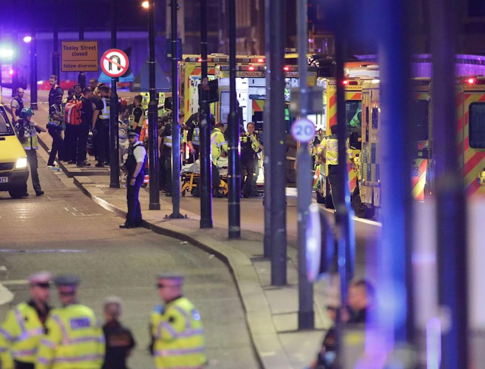 <p>Emergency personnel tend to wounded on London Bridge as a long line of ambulances come to help the injured. Police are dealing with a 'major incident' at London Bridge. (Press Association) </p>