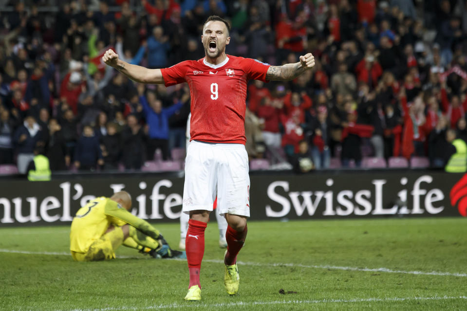 Switzerland forward Haris Seferovic, right, celebrates by Ireland's goalkeeper Darren Randolph, left, after an own goal from Ireland's defender Shane Duffy (not pictured), during their Euro 2020 qualifying Group D soccer match at the Stade de Geneve, in Geneva, Switzerland, Tuesday, Oct. 15, 2019. (Salvatore Di Nolfi/Keystone via AP)