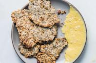 """Gather every seed in your pantry or freezer and make these oat-filled crackers. You can prep them up to a week ahead of your summer party, so there's no need for last-minute baking. <a href=""""https://www.epicurious.com/recipes/food/views/seedy-oat-crackers?mbid=synd_yahoo_rss"""" rel=""""nofollow noopener"""" target=""""_blank"""" data-ylk=""""slk:See recipe."""" class=""""link rapid-noclick-resp"""">See recipe.</a>"""
