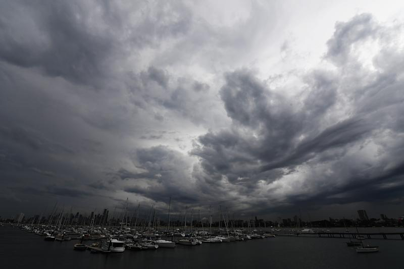 Storm clouds, seen from St Kilda pier, form over Melbourne.