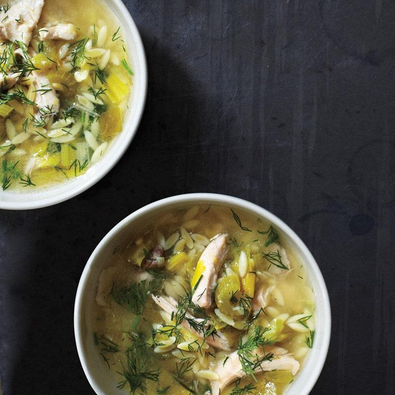 """This weeknight chicken soup goes Greek with orzo, lemon juice, and a handful of fresh dill. <a href=""""https://www.epicurious.com/recipes/food/views/lemony-chicken-and-orzo-soup-51155410?mbid=synd_yahoo_rss"""" rel=""""nofollow noopener"""" target=""""_blank"""" data-ylk=""""slk:See recipe."""" class=""""link rapid-noclick-resp"""">See recipe.</a>"""