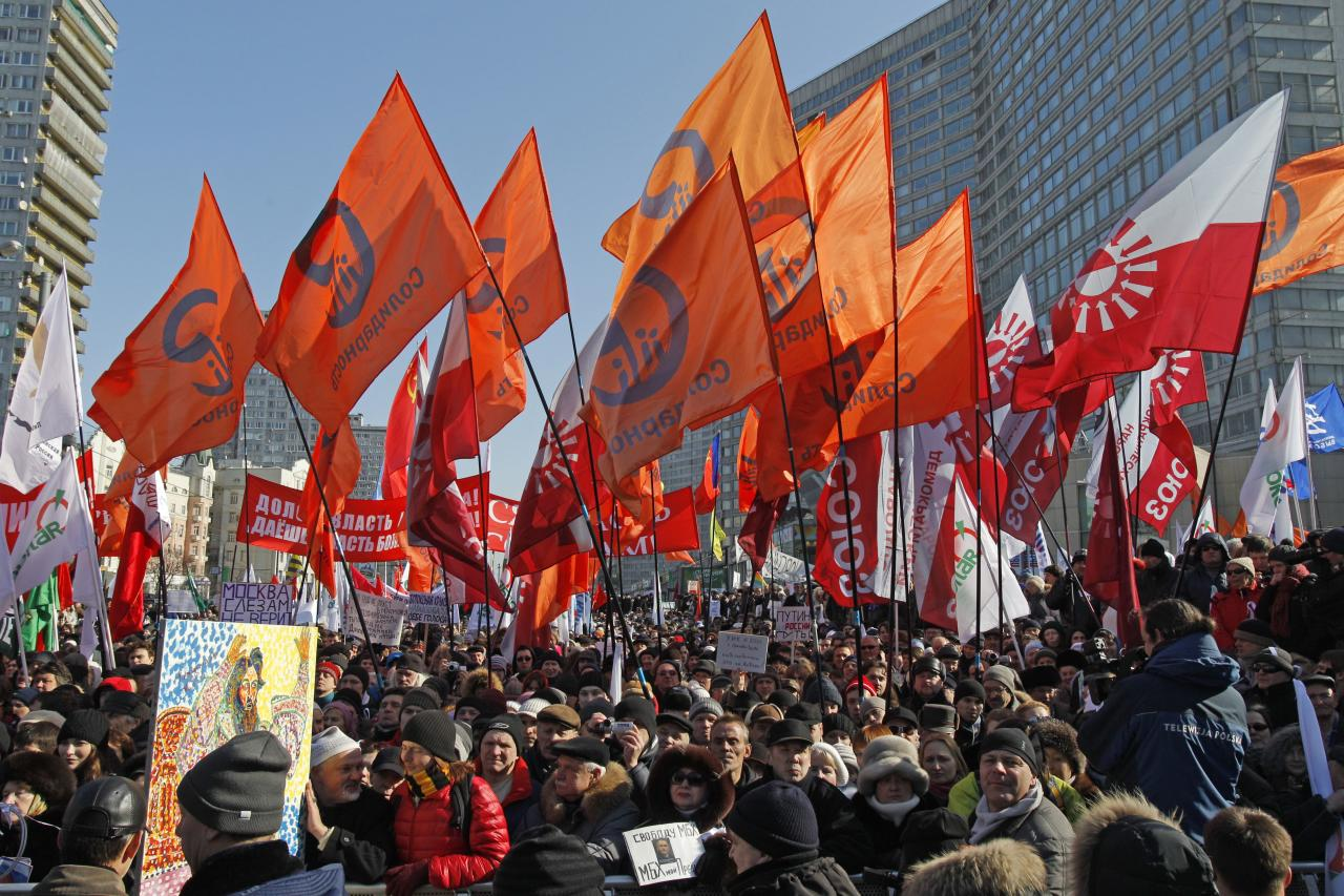Opposition protesters with their flags gathered in center of Moscow during a rally, Russia, Saturday, March 10, 2012. The demonstrators gathered in central Moscow to protest electoral fraud. Saturday's rally is widely seen as evidence of whether the opposition is able to maintain its strength after Vladimir Putin on Sunday won a return to the Kremlin. (AP Photo/Ivan Sekretarev)