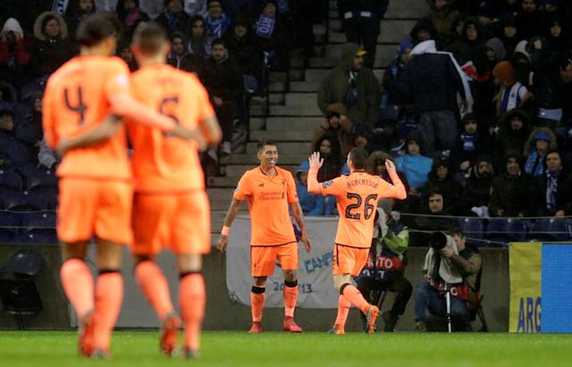 Soccer Football - Champions League Round of 16 First Leg - FC Porto vs Liverpool - Estadio do Dragao, Porto, Portugal - February 14, 2018 Liverpool's Roberto Firmino celebrates scoring their fourth goal with Andrew Robertson REUTERS/Miguel Vidal