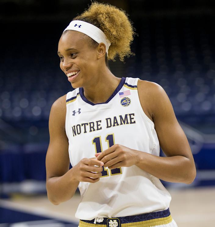 Brianna Turner, then a Notre Dame basketball player, laughs with teammates during the team's media day in October 2018.