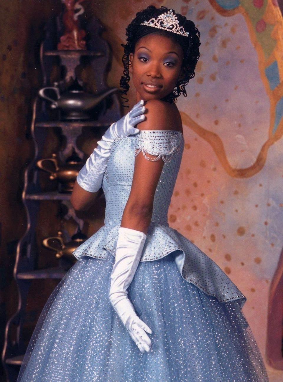 <p>Brandy proved to the world that Black girls everywhere deserve to be princesses when she starred in the 1997 remake of<em> Cinderella.</em> Starring alongside the iconic Whitney Houston, Brandy showed the world that braids and big lips are worthy of royalty. In this classic fairytale, we see a wide array of natural styles. Brandy is sporting box braids fashioned in an updo while her fairy godmother (Whitney Houston) is wearing her curls out, and we can't forget the one and only Whoopie Goldberg who is nothing but royalty playing the queen in her dreadlocks.</p>