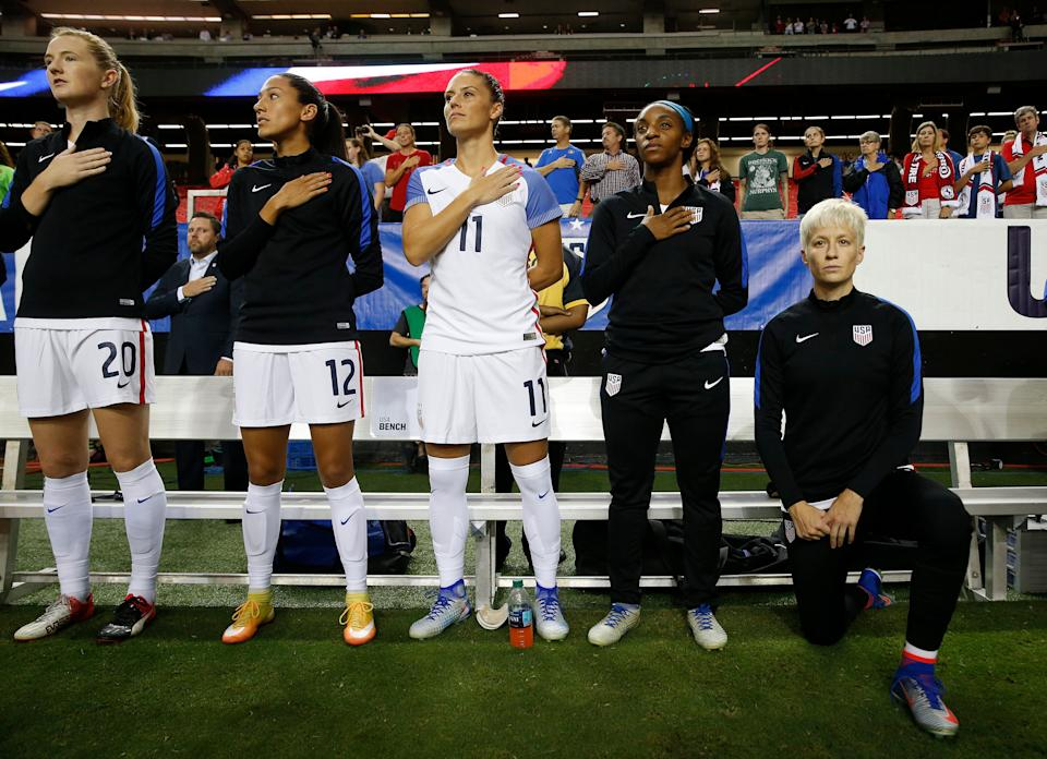 Megan Rapinoe, right, kneels next to teammates Samanth Mewis (20) Christen Press (12), Ali Krieger (11), Crystal Dunn (16) and Ashlyn Harris (22) as the US national anthem is played before an exhibition soccer match against Netherlands in 2016. (AP)