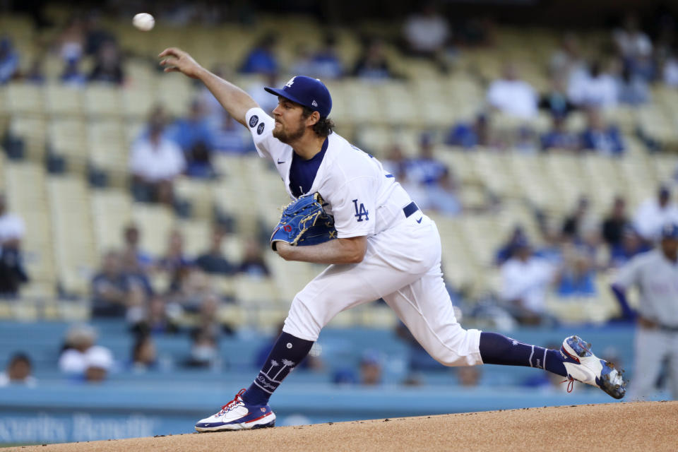 Los Angeles Dodgers starting pitcher Trevor Bauer throws to a Texas Rangers batter during the first inning of a baseball game in Los Angeles on Saturday, June 12, 2021. (AP Photo/Alex Gallardo)