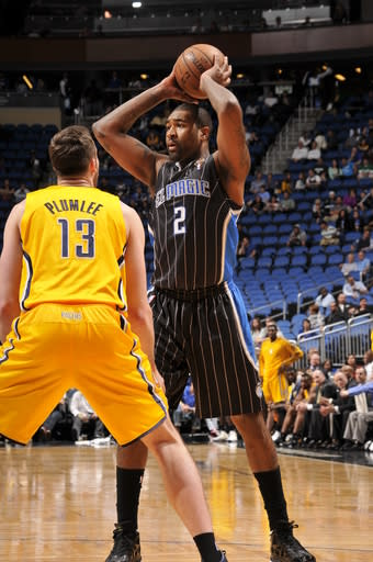 ORLANDO, FL - MARCH 8: Kyle O'Quinn #2 of the Orlando Magic looks to pass the ball against Miles Plumlee #13 of the Indiana Pacers on March 8, 2013 at Amway Center in Orlando, Florida. (Photo by Fernando Medina/NBAE via Getty Images)