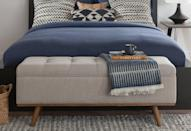 <p>Store extra blankets in the <span>Rick Upholstered Storage Bench</span> ($290, originally $528).</p>