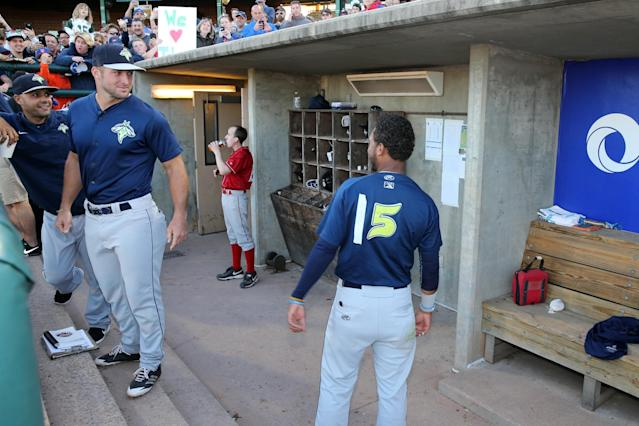 <p>A Tim Tebow impersonator, who altered his uniform to have the same number as the former Heisman Trophy winner, stands in the dugout before the baseball game between the Columbia Fireflies and the Lakewood BlueClaws at FirstEnergy Park, in Lakewood, N.J., on May 15, 2017. (Gordon Donovan/Yahoo News) </p>