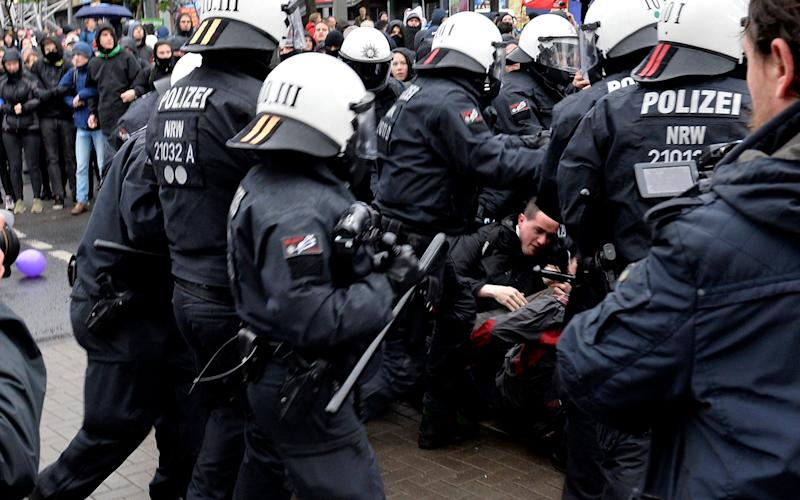 German police in riot gear scuffle with protesters - Credit: EPA