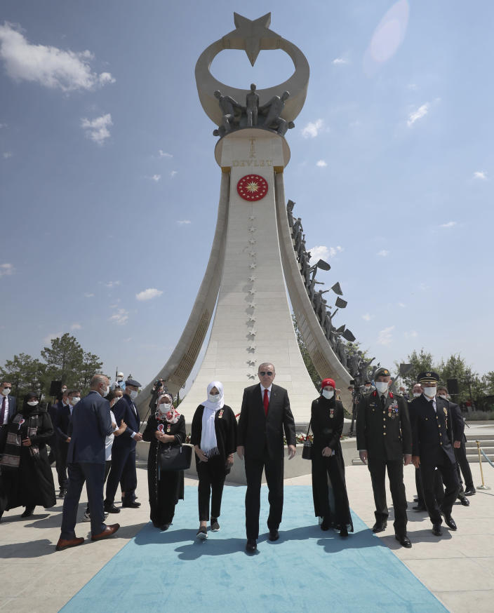 """Turkey's President Recep Tayyip Erdogan and family members of coup victims leave the """"Martyrs Monument"""" outside his presidential palace, in Ankara, Turkey, Wednesday, July 15, 2020. Turkey is marking the fourth anniversary of the July 15 failed coup attempt against the government, with prayers and other events remembering its victims.(Turkish Presidency via AP, Pool) in Ankara, Turkey, Tuesday, July 15, 2020.(Turkish Presidency via AP, Pool)"""