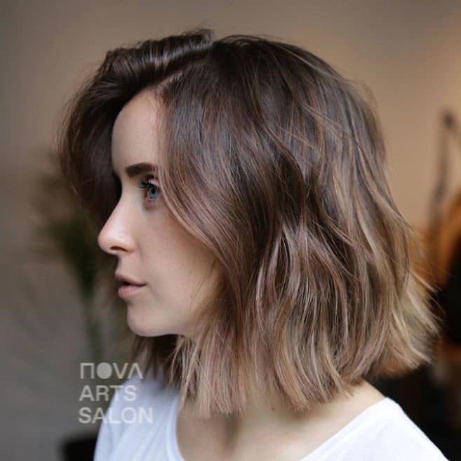 <p>Mousy doesn't mean boring—and this bob says it all. Get yourself a fun new haircut and coat your strands in a shine-enhancing clear gloss, and you'll be feeling brand-new, no color required. </p>