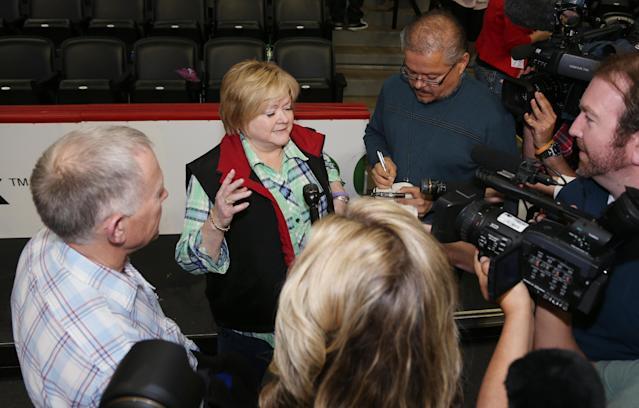Judy Shepard, back center, and her husband, Phillip, far laft, talk to reporters after the couple met with Brooklyn Nets center Jason Collins following the Nets' 112-89 victory over the Denver Nuggets in an NBA basketball game in Denver on Thursday, Feb. 27, 2014. The Shepard's son, Matthew, was killed as part of an anti-gay hate crime in Laramie, Wyo., in 1998. (AP Photo/David Zalubowski)