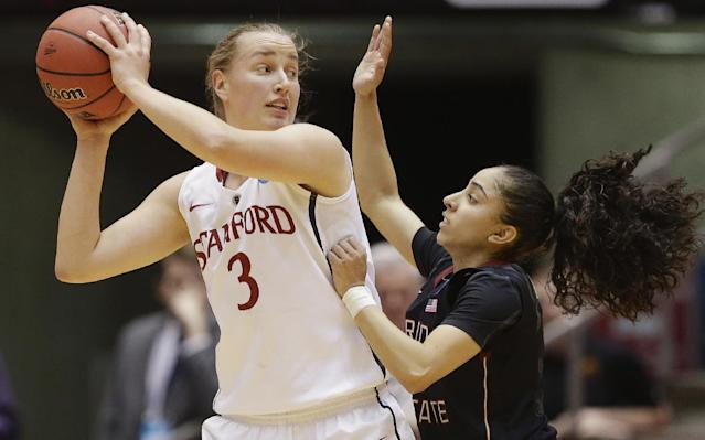 Stanford's Mikaela Ruef (3) is defended by Florida State's Cheetah Delgado (5) in the first half of a second-round game in the NCAA women's college basketball tournament in Ames, Iowa, Monday, March 24, 2014. (AP Photo/Nati Harnik)