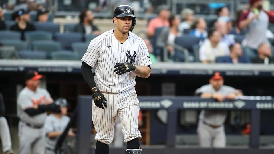 Gary Sanchez reacts to a home run in white pinstripes