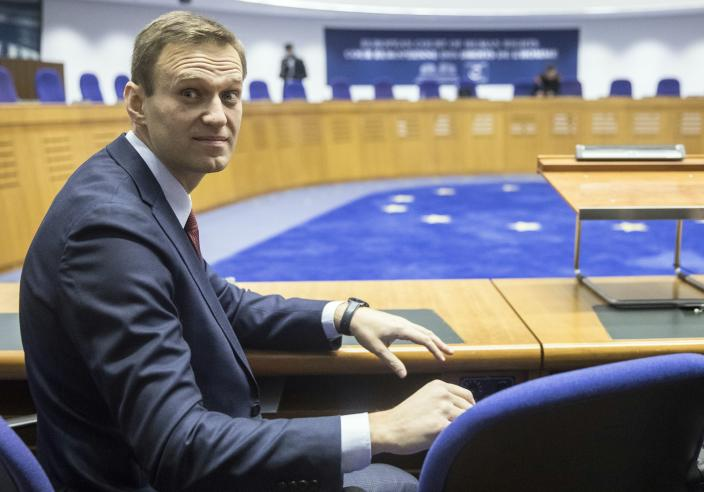 FILE - In this Nov. 15, 2018, file photo, Russian opposition leader Alexei Navalny attends his hearing at the European Court of Human Rights in Strasbourg, eastern France. Navalny is an anti-corruption campaigner and the Kremlin's fiercest critic. He has outlasted many opposition figures and is undeterred by incessant attempts to stop his work. (AP Photo/Jean-Francois Badias, File)