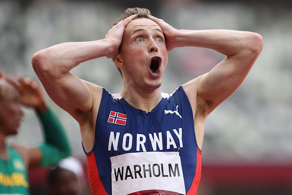 Karsten Warholm can't contain his shock after smashing his own world record to win 400m hurdles Olympic gold (Getty Images)