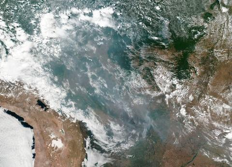 This satellite image provided by NASA shows the fires in Brazil - Credit: AP