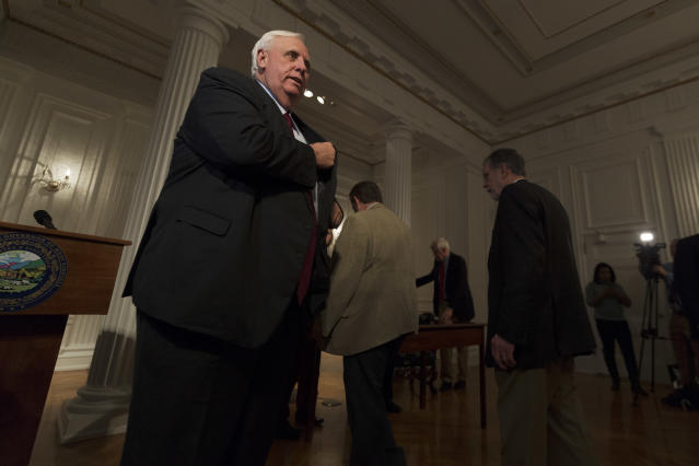 <p>Governor Jim Justice stands up to leave a press conference at the capitol building on the fourth day of statewide walkouts in Charleston, W.Va., on Tuesday, February 27, 2018. (Photo: Craig Hudson/Charleston Gazette-Mail via AP) </p>