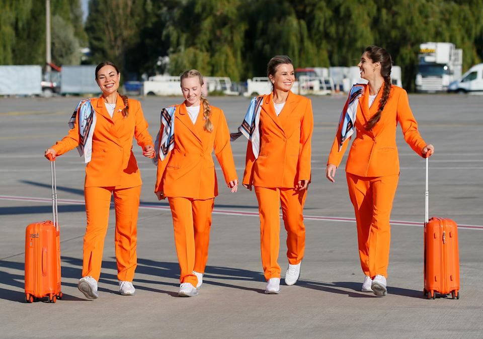 Flight attendants of SkyUp Airlines walk along a tarmac during the presentation of a new uniform at the Boryspil International Airport outside Kyiv, Ukraine September 30, 2021. The Ukrainian low-cost airline presented their innovative uniform, including loose costumes and sneakers, for the crew to feel comfortable and look fashionable during the flights. Picture taken September 30, 2021. REUTERS/Gleb Garanich