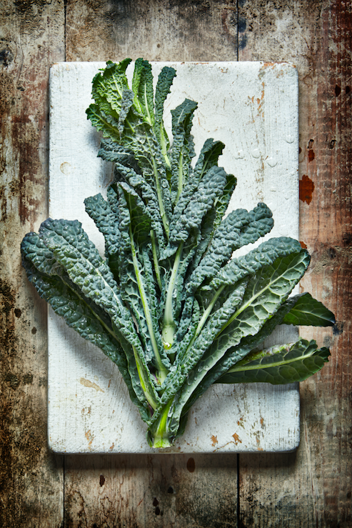 """<p>Insta-foodies can't get enough of kale year-round, but if you can find locally grown kale in autumn, that's the best time to buy it. """"Kale is a fantastic source of vitamin C, vitamin K to support strong bones, glucosinolates like those found in cabbage and Brussels sprouts, and plenty of fibre to support digestion and keep cholesterol in check,"""" says Shona. </p><p>""""With an outstanding nutrient profile you can come close to getting your RDA of anti-inflammatory vitamin A, K and C in just one cup! Kale tastes great steamed, cooked in soups or stews or even juiced,"""" adds Lily.<br></p><p><b>Ramp-up your recipe:</b><br></p><p>Make your own kale crisps. Steam kale for around 10 minutes. Sauté a chopped clove of garlic for a minute or two. Toss the cooked kale with the sautéed garlic, a pinch of chilli flakes, a tablespoon of olive oil and sea salt.<br></p><p><i>[Photo: Getty]</i></p>"""