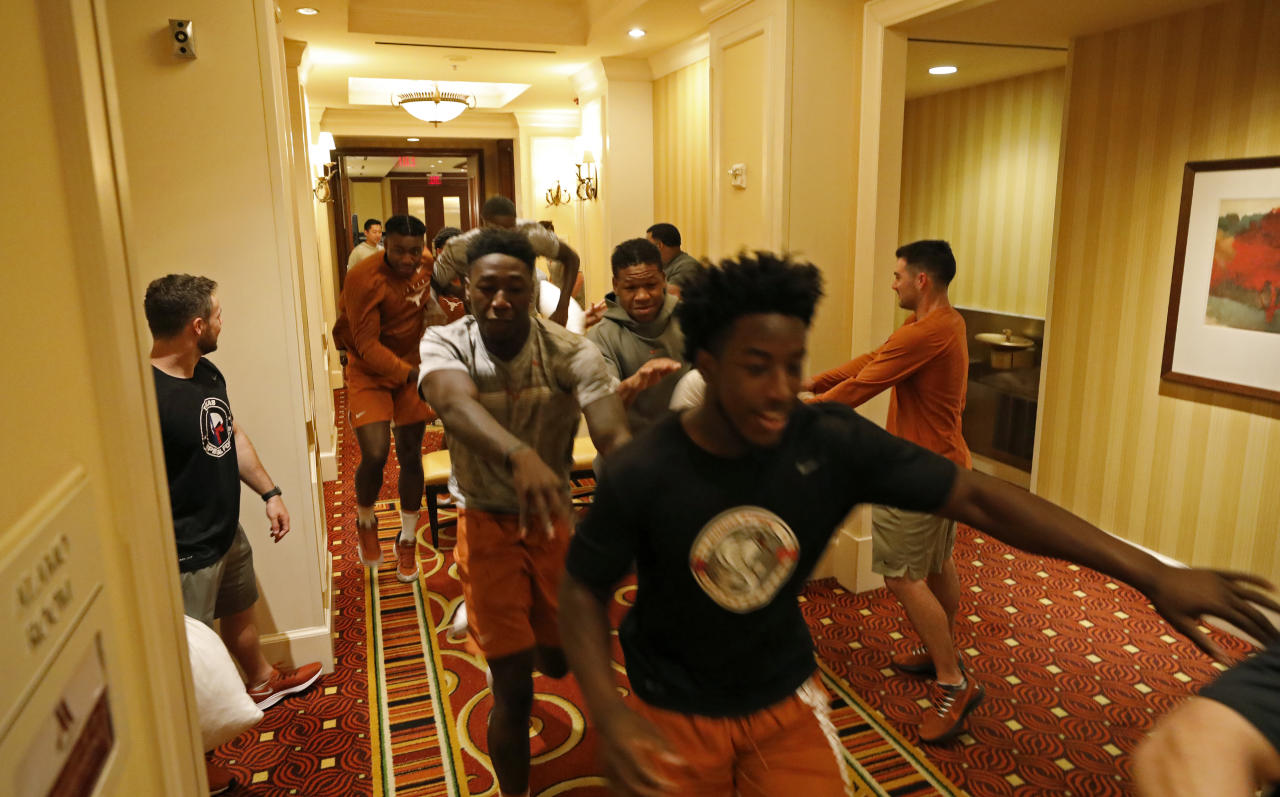 Members of the Texas Longhorns football team run through an obstacle course at the team hotel Saturday Sept. 7, 2019 Austin, Tx. ( Photo by Edward A. Ornelas )