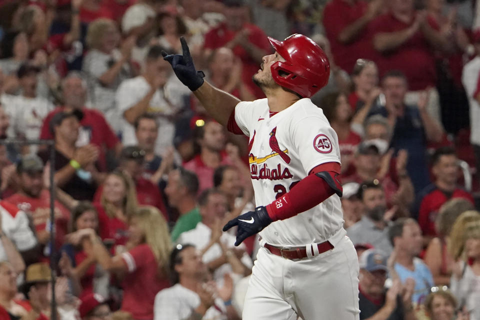 St. Louis Cardinals' Nolan Arenado celebrates after hitting a solo home run during the seventh inning of a baseball game against the Milwaukee Brewers Tuesday, Sept. 28, 2021, in St. Louis. (AP Photo/Jeff Roberson)