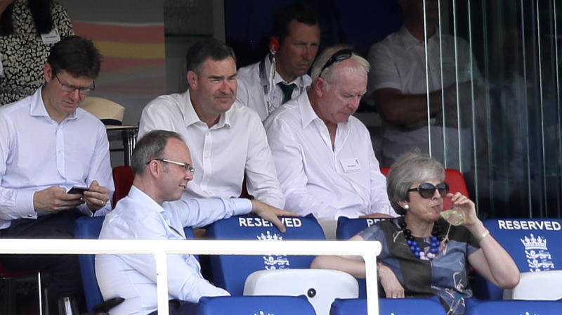 Britain's former Prime Minister Theresa May, bottom right, watches from the stands during the second day of the test match between England and Ireland at Lord's cricket ground in London, Thursday, July 25, 2019. (AP Photo/Kirsty Wigglesworth)