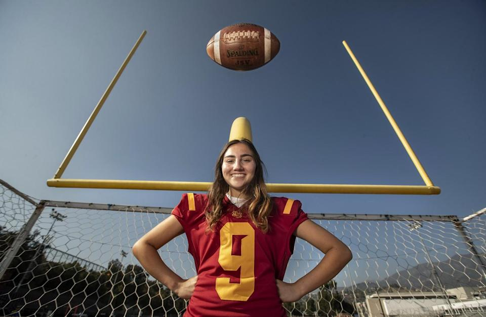 Shaina Clorfeine poses for a photo in the end zone of the La Canada practice field.