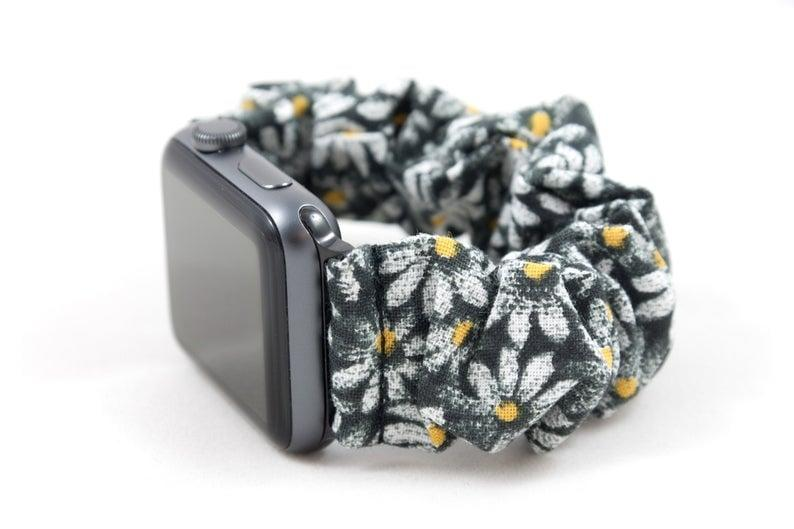 """<p>This <a href=""""https://www.popsugar.com/buy/Daisy-Scrunchie-Watch-Band-488467?p_name=Daisy%20Scrunchie%20Watch%20Band&retailer=etsy.com&pid=488467&price=27&evar1=geek%3Aus&evar9=46586237&evar98=https%3A%2F%2Fwww.popsugar.com%2Fphoto-gallery%2F46586237%2Fimage%2F46586639%2FDaisy-Scrunchie-Watch-Band&list1=tech%2Cshopping%2Cwatches%2Capple%2Cscrunchies%2Cwearable%20tech&prop13=api&pdata=1"""" rel=""""nofollow"""" data-shoppable-link=""""1"""" target=""""_blank"""" class=""""ga-track"""" data-ga-category=""""Related"""" data-ga-label=""""https://www.etsy.com/listing/711768794/daisy-apple-watch-scrunchie-band-38mm"""" data-ga-action=""""In-Line Links"""">Daisy Scrunchie Watch Band</a> ($27) also comes in blue!</p>"""
