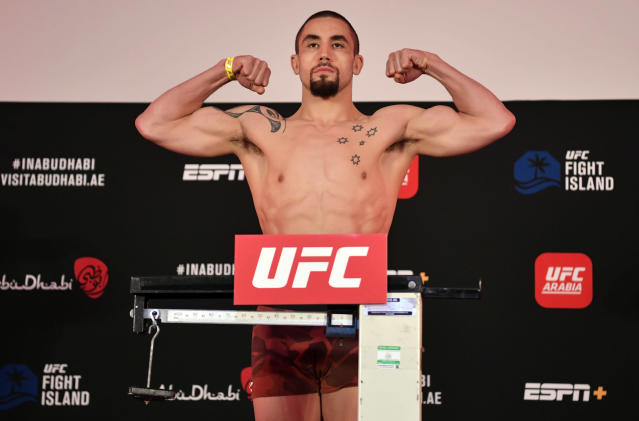 Robert Whittaker of New Zealand poses on the scale during the UFC Fight Night weigh-in inside Flash Forum on UFC Fight Island on Friday in Yas Island, Abu Dhabi. (Photo by Jeff Bottari/Zuffa LLC via Getty Images)