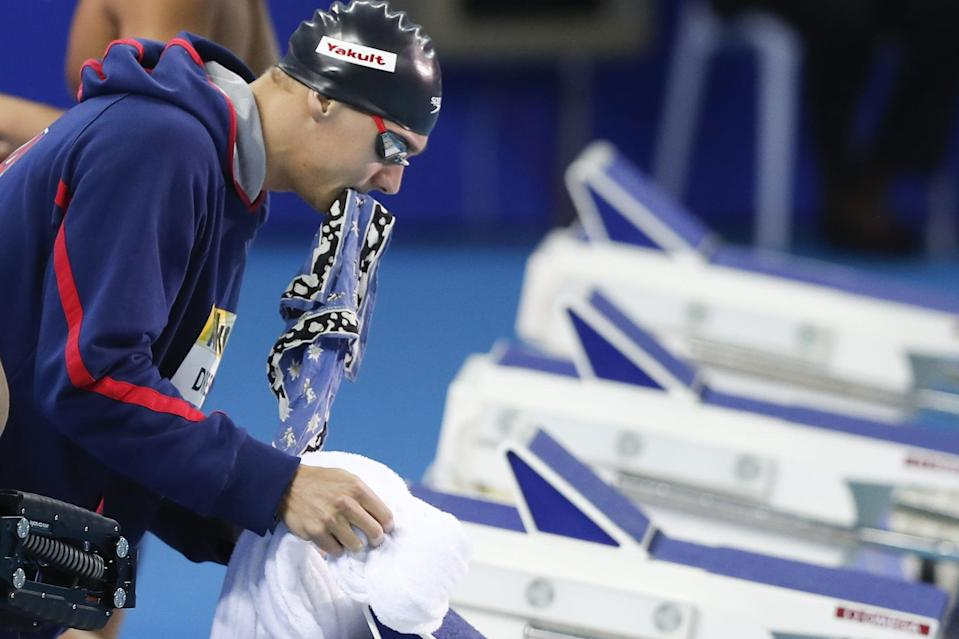 """<p>Although Dressel prefers to keep this part of his life private, he did share with the Associated Press that at swim meets, <a href=""""https://www.businessinsider.com/ap-interview-dressel-a-reluctant-superstar-heading-to-2020-2019-12"""" class=""""link rapid-noclick-resp"""" rel=""""nofollow noopener"""" target=""""_blank"""" data-ylk=""""slk:he always carries a blue and black, cow patterned bandana"""">he always carries a blue and black, cow patterned bandana</a>, which previously belonged to his high school math teacher, Claire McCool, who died from breast cancer in 2017. """"It's just something special that I get to hold on to that represents her, something physical,"""" he explained. Mrs. McCool was a longtime supporter and confidant of Dressel's. Her bandana was gifted to Dressel by her husband after her death. """"<a href=""""http://www.youtube.com/watch?v=mkurwn5Jyj0"""" class=""""link rapid-noclick-resp"""" rel=""""nofollow noopener"""" target=""""_blank"""" data-ylk=""""slk:She's with me every race"""">She's with me every race</a>, and she will be until I finish my career,"""" Dressel told <strong>Swimming World</strong> in 2018.</p>"""
