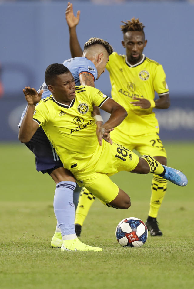 Columbus Crew midfielder Luis Diaz, left, sends New York City FC defender Ronald Matarrita (22) to the ground as Columbus defender Harrison Afful, right, looks on during the second half of an MLS soccer match, Wednesday, Aug. 21, 2019, in New York. New York City FC defeated Columbus 1-0. (AP Photo/Kathy Willens)