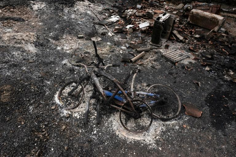 A picture taken on July 4, 2021 shows a pair of burnt bicycles near Ora village in Cyprus' Troodos mountain range
